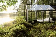 The structure is comprised of sheets of glass, a steel armature, and a wood shed that hugs the rear facade