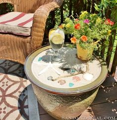 Great idea for the deck and a way to show off seashell collection. Easy to Make Glass Top Display Side Table