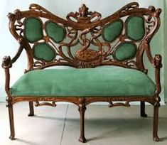 Art Nouveau furnishings.  organic lines and and earthy green material, nature inspired.