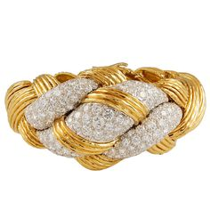 DAVID WEBB Diamond Gold Knot Bracelet | From a unique collection of vintage bangles at https://www.1stdibs.com/jewelry/bracelets/bangles/