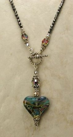 Beaded Jewelry LOVE this! Faceted hematite or Czech beads necklace with toggle link and heart bead surrounded by bali beaded spaders and caps. Wire Jewelry, Jewelry Crafts, Beaded Jewelry, Jewelery, Jewelry Necklaces, Jewelry Ideas, Jewellery Box, Jewelry Trends, Jewellery Shops