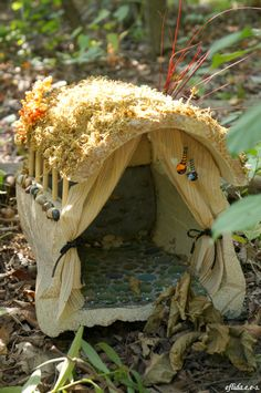 A fairy house with floor marbles at Michigan Renaissance Faire 2012.
