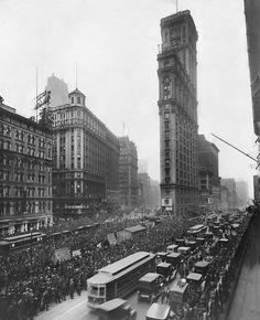 Times Square, 1919 — World Series results on remote scoreboard.