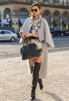Miranda Kerr wearing a cape with over-the-knee boots #streetstyle