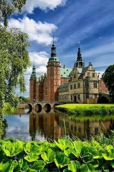 Fredericsborg Castle, Denmark | Oldest parts of the castle date back to 1560, built for King Christian IV. The Largest Renaissance castle in Scandinavia, located on 3 small islands in the middle of Palace Lake and adjoined by a Large formal baroque style garden.
