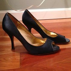 Navy blue satin heals This is a navy blue pump. Worn once to a formal event. Bottoms are somewhat scuffed up, but top and heal portion are in excellent condition. Enzo Angiolini Shoes