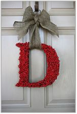 Fun initial wreath made with holly berries for Christmas