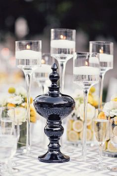 Tall glass candle holders add height without heaviness to the tablescape. #viceroy #weddings