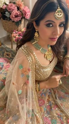 An elegant golden lehenga with detailed floral embroidery with zardozi work paired with emerald and kundan jewellery perfect for your mehendi or sangeet function (C) Natasha Luthra #wittyvows #indianwedding #indianfashion #indianbride #bridetobe #indianweddinginspiration #bridaloutfit #mehendioutfit #goldenlehenga #floral #weddingideas #mehendifunction Party Wear Indian Dresses, Dress Indian Style, Bride Dresses, Mehendi Outfits, Bridal Outfits, Desi Wedding, Wedding Attire, Bridal Fashion, Couture Fashion