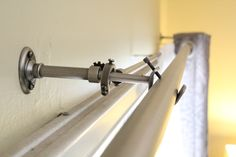 Curtain rod over vertical blinds