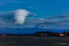 EPIC! Lenticular clouds seen late last year over Mount Rainier in Washington. Photo credit: Ian McRae. #WAwx