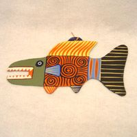 Another in our line of exciting products made from recycled materials is this scary fish, painted on flattened pieces of recycled rubber by artisans in South Africa. A great decoration for a beach dwelling, the room of someone who loves tropical fish, or just as an example of primitive art. Each piece is individually created, painted and signed on the back by the artist.