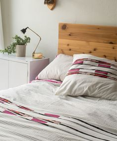 FAIR TRADE! Beautiful, simple and understated, this bedding set features contrasting fuschia, orange, black and grey patterns artfully hand blockprinted on a neutral toned backdrop. Each piece is handmade in an ethical manner through direct partnership with a growing network of artisans in India.