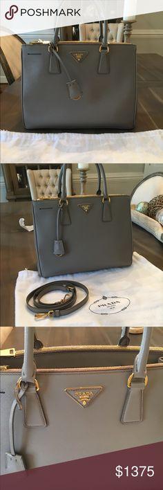 Prada Saffiano leather handbag in Argilla gray Prada Saffiano Handbag in Argilla gray with gold hardware.  12.5 W x 9.5 H x 5.25 D.  Impeccable condition barely used. Prada Bags