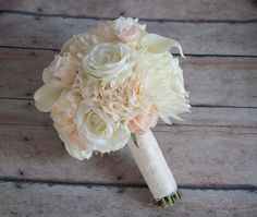 A soft and elegant wedding bouquet with blush pink and ivory garden roses, rose buds, hydrangeas, and mums, accented with soft ivory calla lilies. This wedding bouquet is wrapped in ivory satin and la Wedding Flower Arrangements, Flower Centerpieces, Flower Decorations, Wedding Centerpieces, Wedding Decorations, Wedding Ideas, Wedding Planning, Church Wedding Flowers, Flower Bouquet Wedding