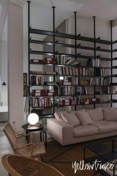 Living room bookshelf...De Padova Showroom Milan, Photo © Nick Hughes/ Yellowtrace