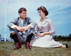 Jack Kennedy and Jacqueline Bouvier John F. Kennedy and Jacqueline Bouvier sit together in the sunshine at Kennedy's family home at Hyannis Port, Massachusetts, a few months before their wedding.