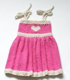 Little Sweetheart Sundress This simply constructed dress pattern features an empire waist and sweet, bow tie straps. Interest and texture is added with a seed stitch waist band and edging. Read more at http://www.allfreeknitting.com/Knitting-for-Babies/Little-Sweetheart-Sundress Yarn Weight: (4) Medium Weight/Worsted Weight and Aran (16-20 stitches to 4 inches)