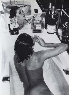 Combining several of life's little pleasures- bathing champagne, perfume, and flowers :)