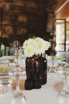 like the pop of white flowers against the amber bottles Best Destination Wedding Locations, Wedding Blog, Wedding Ideas, Recycle Your Wedding, Amber Bottles, Medicine Bottles, Centerpieces, Table Decorations, Vintage Interiors