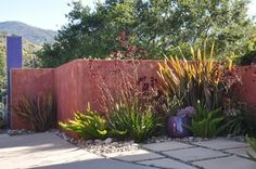Bold Backdrops for Colorful Gardens Use painted walls as tools in the garden, solving problems in a most artistic way