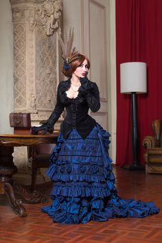 A midnight blue XIX century skirt for a graceful Victorian lady. We were inspired by old Victorian postcards, XIX century fashion magazines, as well as Victorian-themed movies. Materials: taffeta, velvet trim, lace, glass beads. The skirt consists of underskirt, and overskirt. The