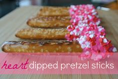 Heart dipped pretzel sticks for Valentine's Day. Easy treat and craft for under 5 dollars #valentines #treats #funlunch