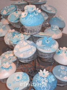Baby shower cupcakes with blue color flower theme. Since it is cupcake tower it looks so nice.