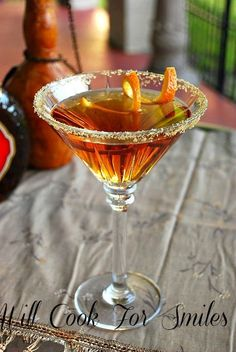 Amaretto-Peach Martini - Peach Schnapps, Vodka, Amaretto, Club Soda, Juice of an Orange and Brown Sugar rimmed glass