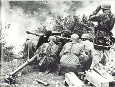German paratroopers fighting as infantry defend their position with a PaK 38 anti-tank gun somewhere in Italy, 1944.