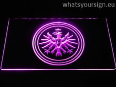Eintracht Frankfurt - LED neon light sign display made of the first-class quality transparent plastic and briliant colorful illumination. The neon sign looks exactly the same from every angle thanks to the carving with the latest 3D laser engraving process. This LED neon sign is a great gift idea! The neon is provided with a metal chain for displaying. Available in 3 sizes in following colours: White, Green, Red, Blue, Yellow, Purple and Orange!