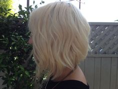 Shaggy, A-Line Beachy Bob Haircut - The texturized look creates volume and body with longer layers towards the face -- a sophisticated yet casual style.