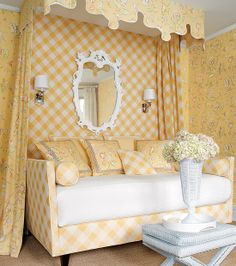 Yellow bedroom with buffalo check and floral fabric, sconces, daybed with petite canopy