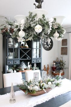 Neutral farmhouse style Christmas dining room. Pretty metallics and whites with flocked greenery.