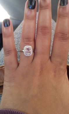 Pink moissanite with rose gold and pink diamond halo