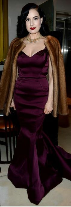 Who made Dita Von Teese's dark red gown that she wore in New York on December 11, 2013?
