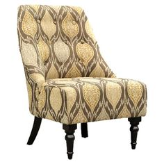 Button-tufted club chair with ikat motif.  Product: ChairConstruction Material: Wood and fabricColor:...
