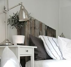 Use old wood pallets to make a bed frame.