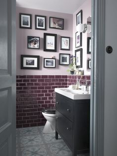 Who says you can't furnish the bathroom and make it even more personal with a bathroom gallery.