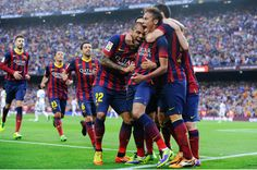 Neymar (2nd R) celebrates with his team-mates after scoring the opening goal during the La Liga match between FC Barcelona and Real Madrid CF at Camp Nou on October 26, 2013 in Barcelona, Catalonia.