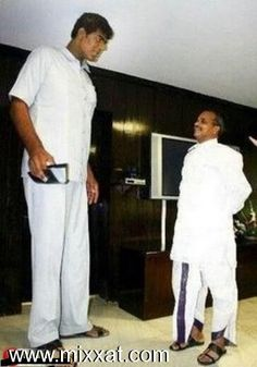 Vikas Uppal - 8 feet 2 inches (248.9 cm). He was the Tallest man in India until his death in 2007 - http://www.thetallestman.com/vikasuppal.htm