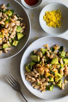 NYT Cooking: Buttery avocado and creamy cannellini beans are a natural combination in this easy salad, and a quick garlic oil provides . Vegetarian Recipes, Cooking Recipes, Healthy Recipes, Bean Recipes, Easy Cooking, Garlic Oil Recipe, Cannellini Bean Salad, Jai Faim, Avocado Salat