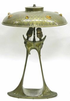 Austrian Art Nouveau bronze lamp with a flattened domed circular shade with a stamped waveform motif and flaring to a. Art Antique, Antique Lamps, Antique Furniture, Art Nouveau Furniture, Design Furniture, Chandeliers, Bronze Art, Lampe Art Deco, Jugendstil Design