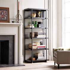 """Flat-Bar Bookcase $399.00 Powder-coated metal frame and legs. 30""""l x 15""""w x 69""""h. Six open, fixed shelves for storage and display that increase in height from top to bottom. [www.westelm.com]"""