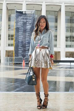 We love the way Aimee Song paired her denim shirt with a metallic skirt and gorgeous heels.