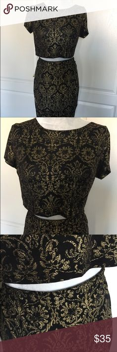 """Forever 21 + makes this cropped top and skirt set Forever 21 + makes this cropped top and skirt set. Done in a lightweight poly with black background and golden print. It's really lovely just not my style. It's a 1x in size but this would fit a L or XL.  Bust 18"""" length 14"""". Skirt 16"""" at elastic waist and 24"""" long. Tons of stretch. Reposh. I would  you to peek at my closet, and bundle what you like. Everything I sell is authentic, as everything I buy is authentic. Thanks for looking…"""