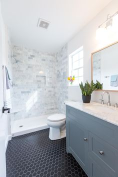 Carrara Marble tile shower surround, Black hex tile, Gray vanity with Carrara marble top, wide spread faucet, White Oak mirror. 65 Most Popular Small Bathroom Remodel Ideas on a Budget in 2018 Shower Surround, Small Master Bathroom, Bathroom Inspiration, Bathroom Shower Tile, Master Bathroom Decor, Amazing Bathrooms, Bathrooms Remodel, Marble Shower Tile, Farmhouse Master Bathroom