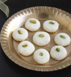 Make Sandesh Recipe at Home. Boil milk in a thick-bottomed large pan, add water and lemon juice to the boiling milk .Keep stirring till the milk curdles completely and flame off. Indian Desserts, Indian Sweets, Indian Dishes, Sweet Desserts, Indian Food Recipes, Bangladeshi Food, Bengali Food, Bangladeshi Recipes, Sweets Recipes