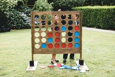 Connect Four is that nostalgic game most of us grew up playing--and we love this giant version, so that all your guests can watch.     Photography by   Bake Photography  as seen in   this real wedding .