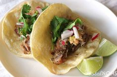 Carnitas, or Mexican pulled pork, are a tasty filling for tacos. Pork shoulder is cooked low and slow until the meat becomes tender and melts in your mouth. This is a perfect main course for Cinco de Mayo.